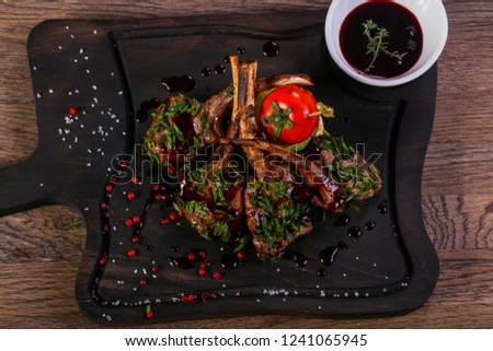 Roasted lamb ribs with sauce #1241065945