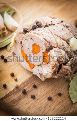 Roasted meat roll with carrot and spices
