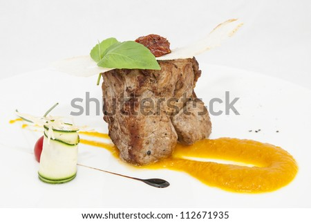 roasted meat with sauce on a white background
