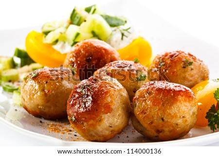 Roasted meatballs and vegetable salad