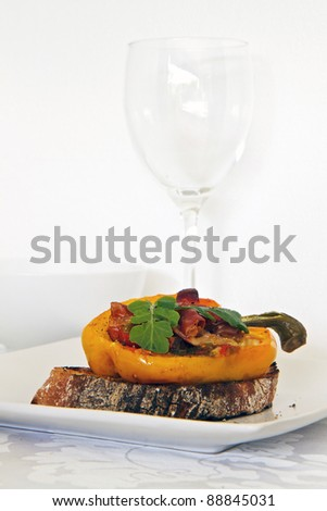 Roasted peppers with italian bread and wine glass