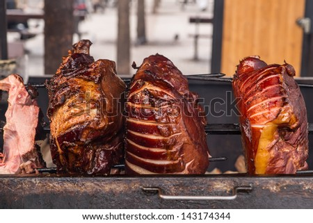 Roasted pig on the spit for a big party