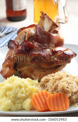 Roasted pork knuckle with mashed potato and braised sauerkraut