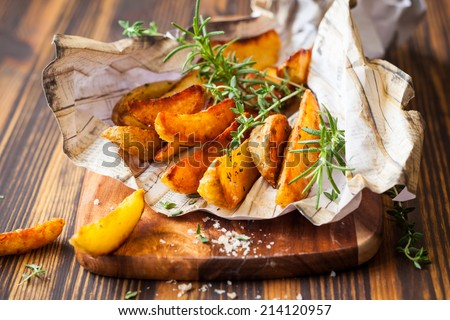 Roasted potato wedges with herbs and salt Stock photo ©
