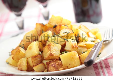 Roasted potato with rosemary and red wine. Shallow DOF