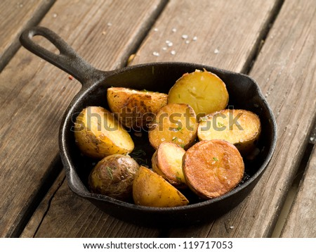 Roasted potato with salt and dill, selective focus