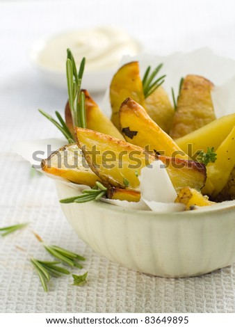 Roasted potatoes with herbs in bowl. Selective focus