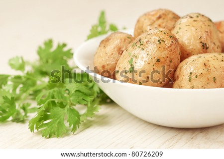 Roasted potatoes with parsley in bowl