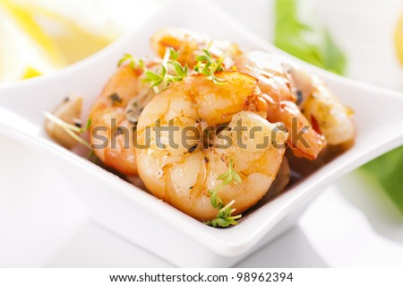 roasted prawns in white plate