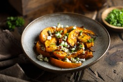 Roasted pumpkin with cheese and herbs