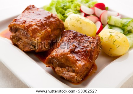 Roasted ribs and vegetables