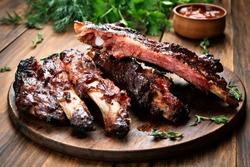 Roasted sliced barbecue pork ribs, focus on sliced meat