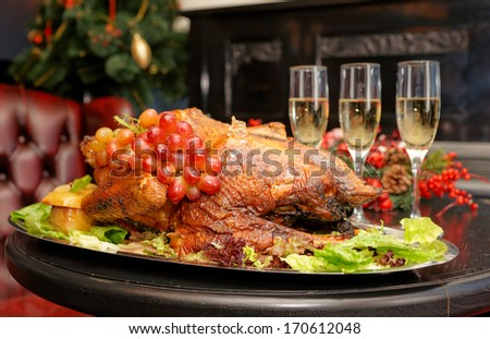 Roasted thanksgiving turkey on restaurant table with champagne
