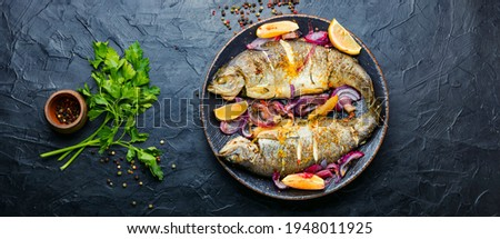 Roasted trout with lemon and onion on plate.Grilled trout Stock photo ©
