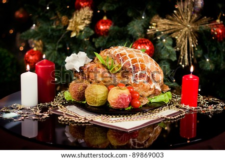 Roasted turkey and candles on a christmas new year table
