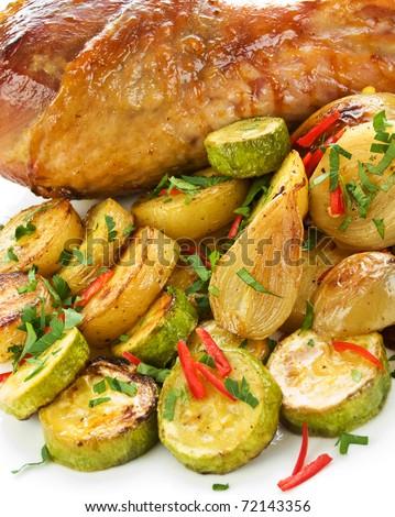 Roasted turkey leg with vegetables. Shallow dof.