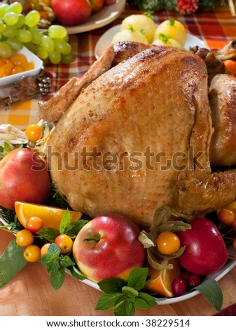 roasted turkey on holiday decorated table