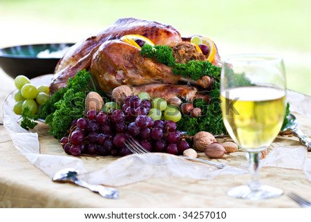 Roasted turkey on holiday table ready to eat.