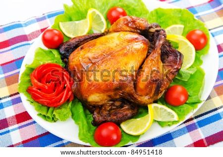 Roasted turkey on the festive table - stock photo