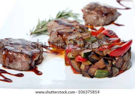 Roasted vegetables and grilled meat with chocolate sauce