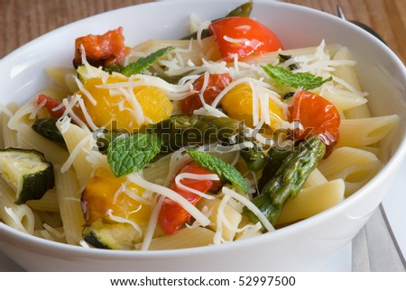 stock photo : Roasted vegetables with pasta penne