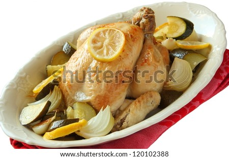 Roasted whole chicken with lemon, zucchini and onions over white