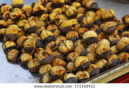 Roasting chestnuts on the grill by a street vendor in Istanbul, Turkey