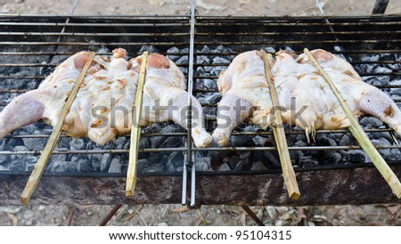 Roasting chicken on the chargrill - stock photo