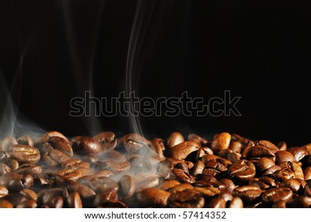 roasting coffe with smoke and black background