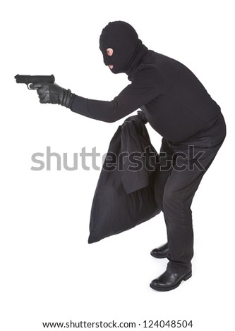 robber aiming with his gun isolated on white
