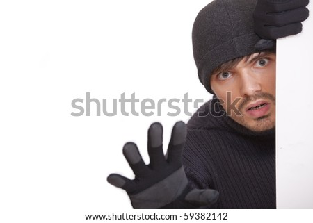 robber hiding under a white board - isolated