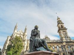 Robert Burns statue, Dunedin Town Hall and St. Paul's Cathedral. (Dunedin, NZ)