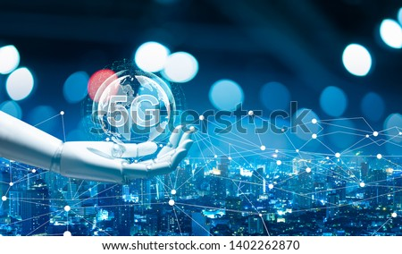 Robot android hand holding icon 5g.5G network digital hologram and internet of things on city background.5G network wireless systems.robot android hand holding icon 5g.