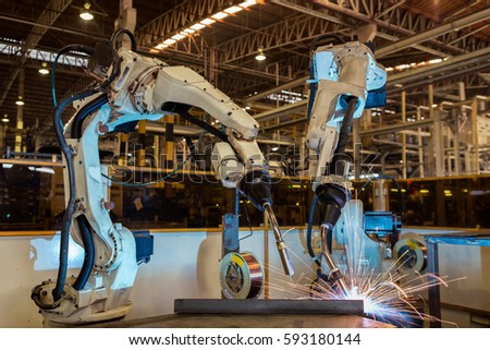 Robot are welding assembly part in car factory