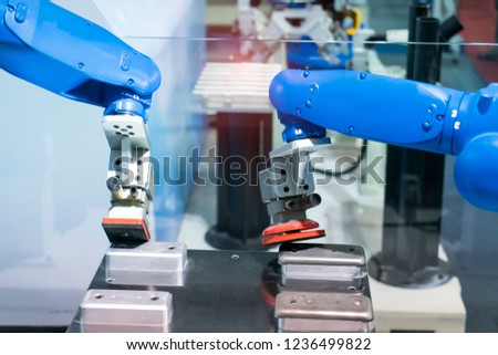 robot arm polishing the automotive part in the production line.
