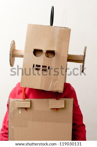 Robot Girl. Little girl with a cardboard box on his head.