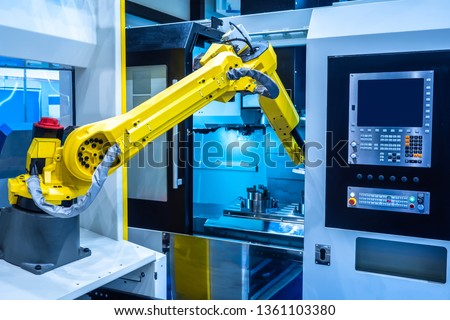 Robot hand. Industrial manipulator. The robot performs turning work. Robotics at work. Automation of production. Robots in production.