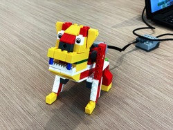 Robot lego dog that is programmed by children through coding during a lesson in stem education.