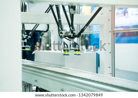 robot with vacuum suckers with conveyor in manufacture factory,Smart factory industry 4.0 concept