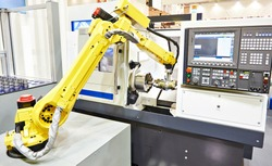Robotic arm and cnc lathe machine