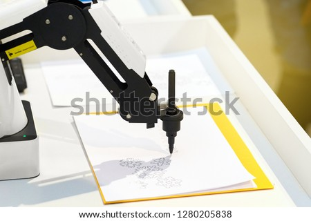 Robotic hand with a pencil draws simple graphic drawings on white paper. Future and art concept. #1280205838