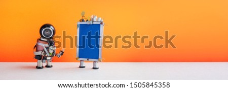 Robotic helpline customer service call center operator concept. Friendly robot assistant with modern phone on orange background. copy space.