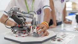 Robotic lab class with school students blur background in AI learning or group study workshop in science technology engineering classroom for STEM education