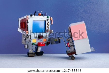 Robotic logistic delivery service concept. Robot moving containers with powered pallet jack. Forklift cart mechanism and boxes on blue wall, gray floor background. Copy space, mockup photography.