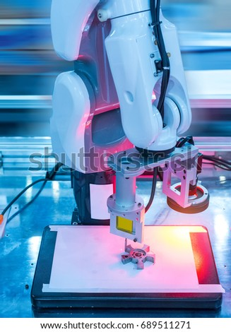 Robotic machine vision system in factory,automated scanning.
