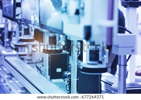 Robotic machine vision system in phone factory #677264371
