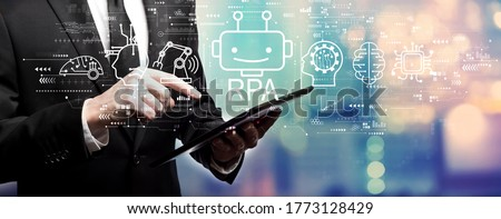 Robotic Process Automation RPA theme with businessman using his tablet computer Stock photo ©