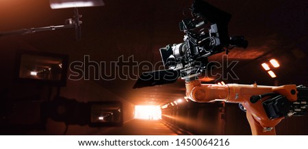 Robotics automatic arms machine of making movie and TV commercial in studio. Camera of movie. Innovation and technology of movie industry with monitoring system software. Film crew team in set. #1450064216