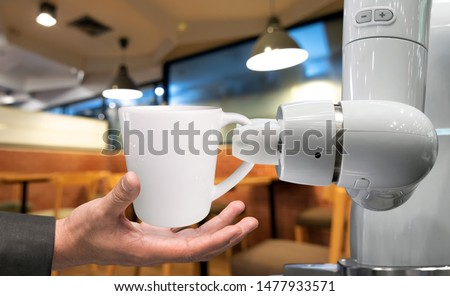 Robotics Trends technology business concept. Automation collaborative robot technology robot arm for serve a cup of coffee in restaurant to human.