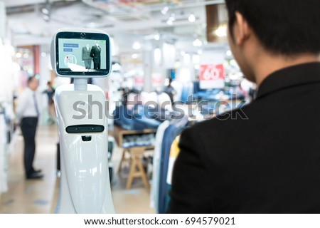 Robotics Trends technology , smart retail business concept. Autonomous personal assistant robot for navigation customer to search items in fashion shopping mall.